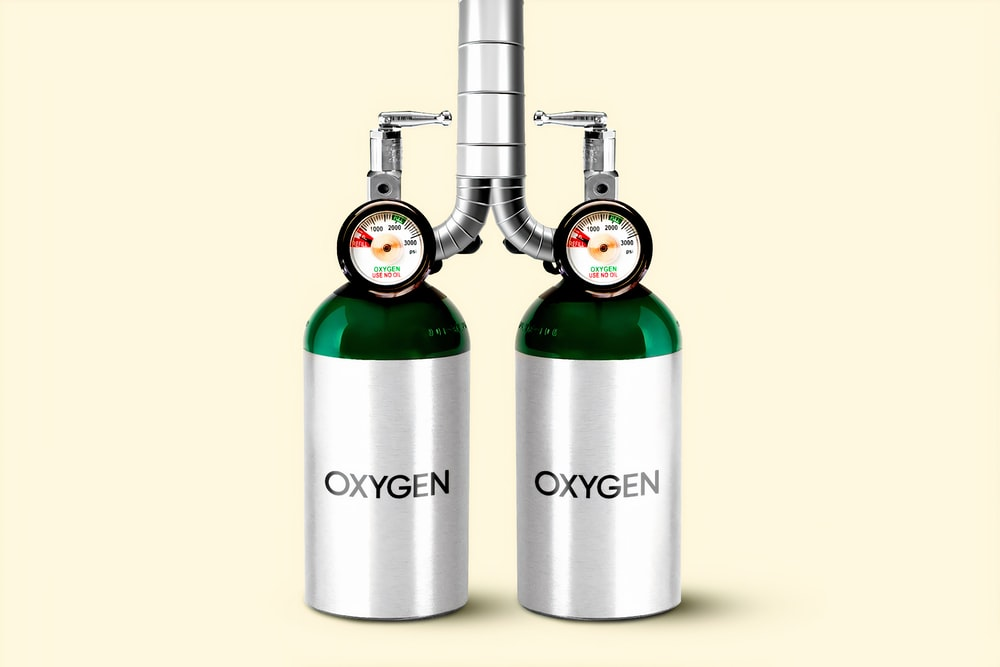 2 green and silver bottles