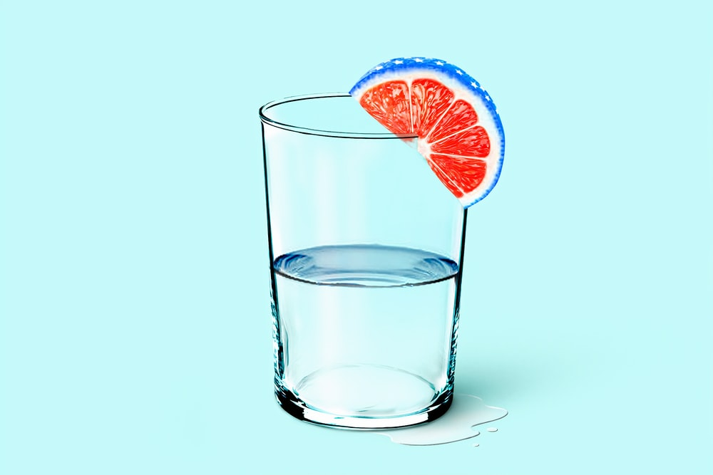 clear drinking glass with lemon