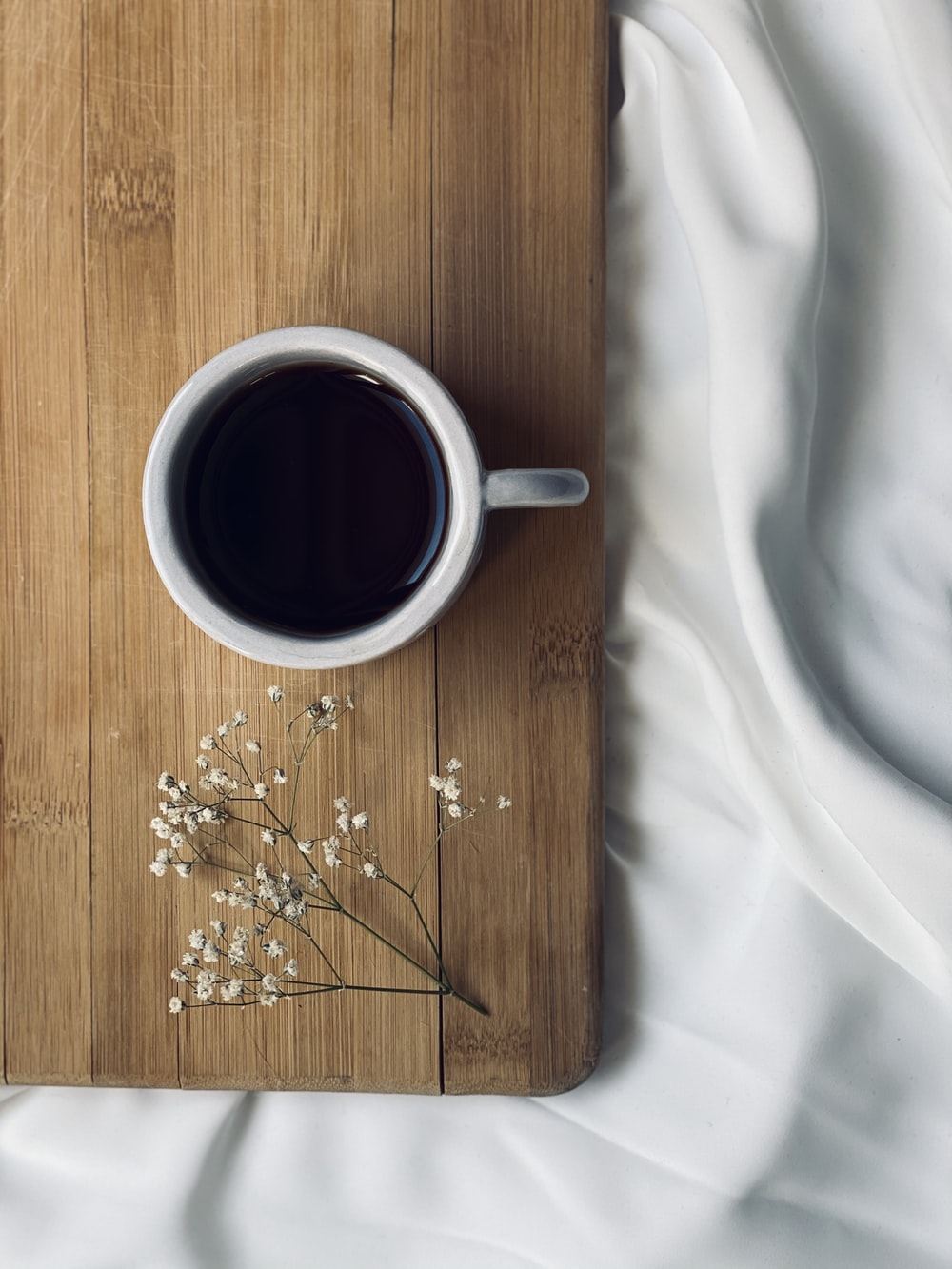 black coffee in white ceramic mug on brown wooden table