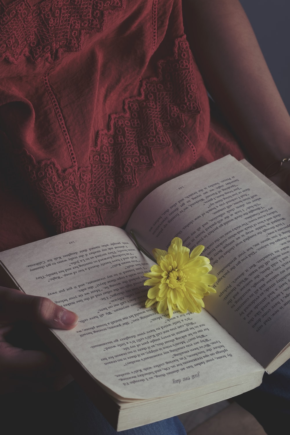 yellow flower on white book page