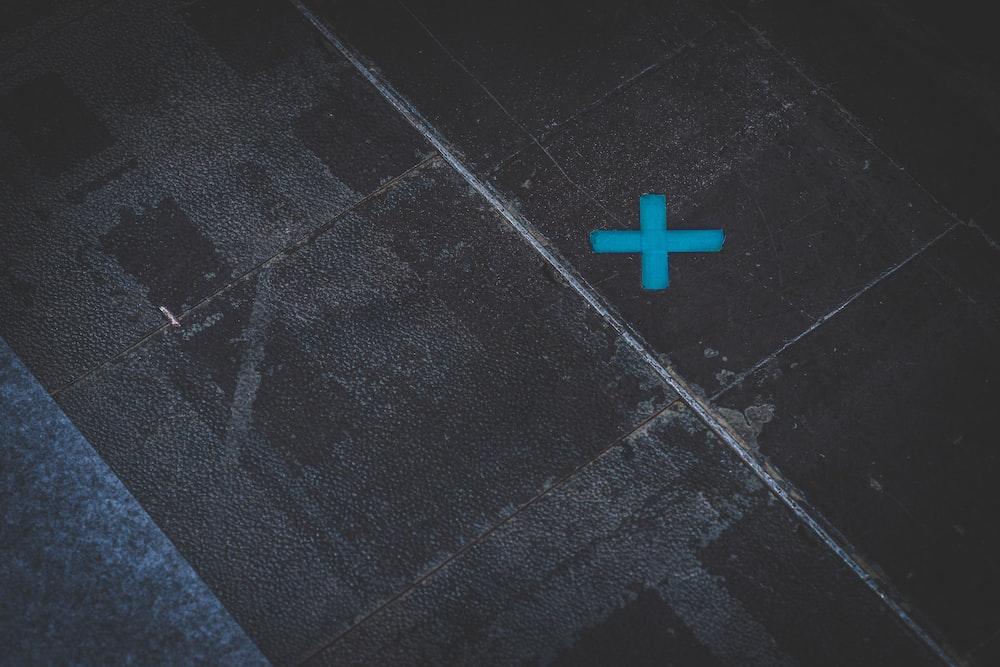 red cross on gray concrete floor