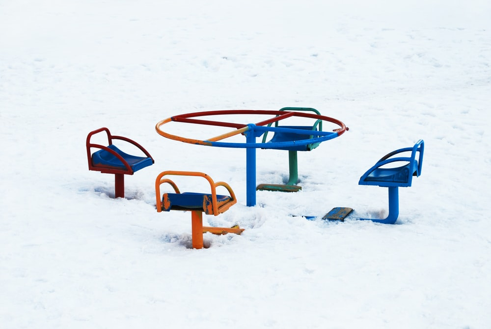 red and blue metal frame on snow covered ground