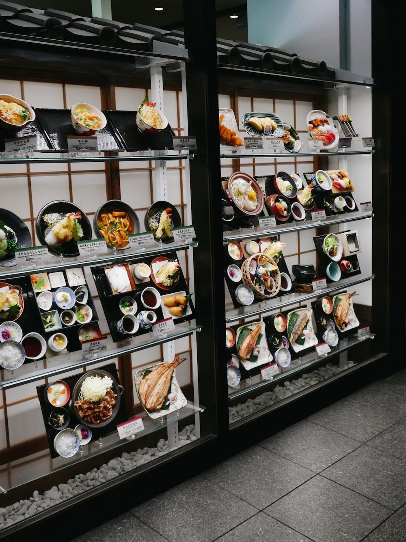 assorted food on black wooden shelf