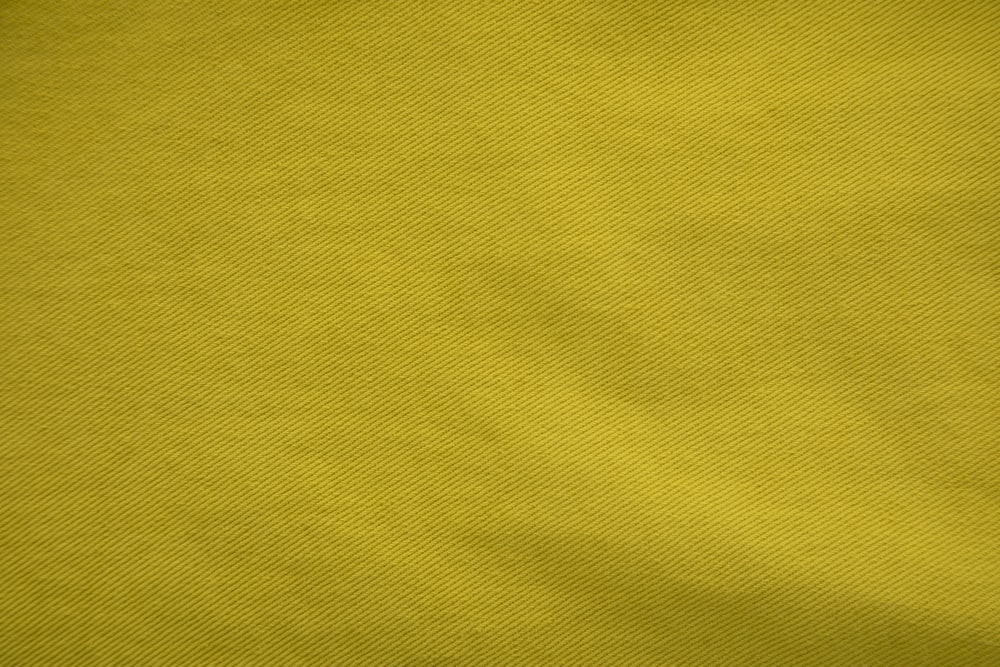 yellow textile in close up photography