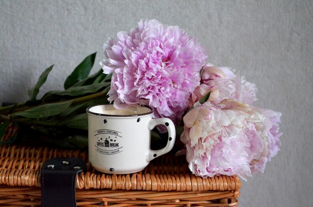 white ceramic mug on brown woven table