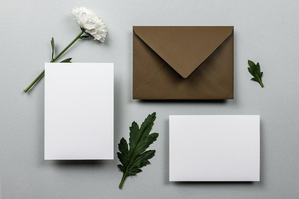 brown envelope beside white paper