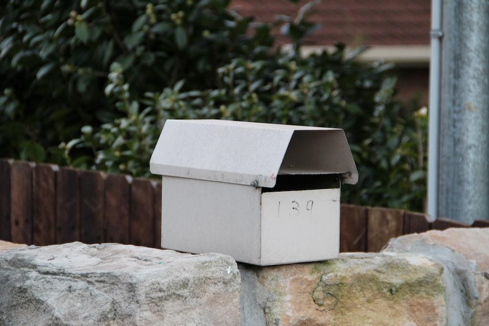 white box on gray concrete bench