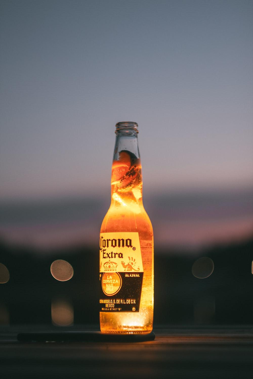 selective focus photography of corona extra bottle