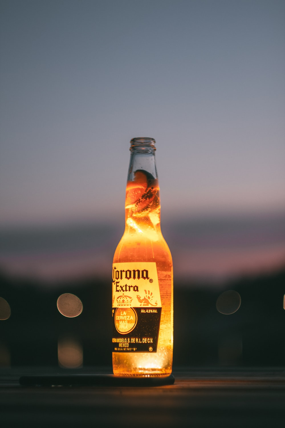 selective focus photography of corona extra bottle