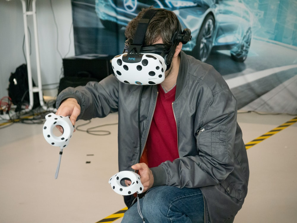 man in black jacket and blue denim jeans with white and black panda mask