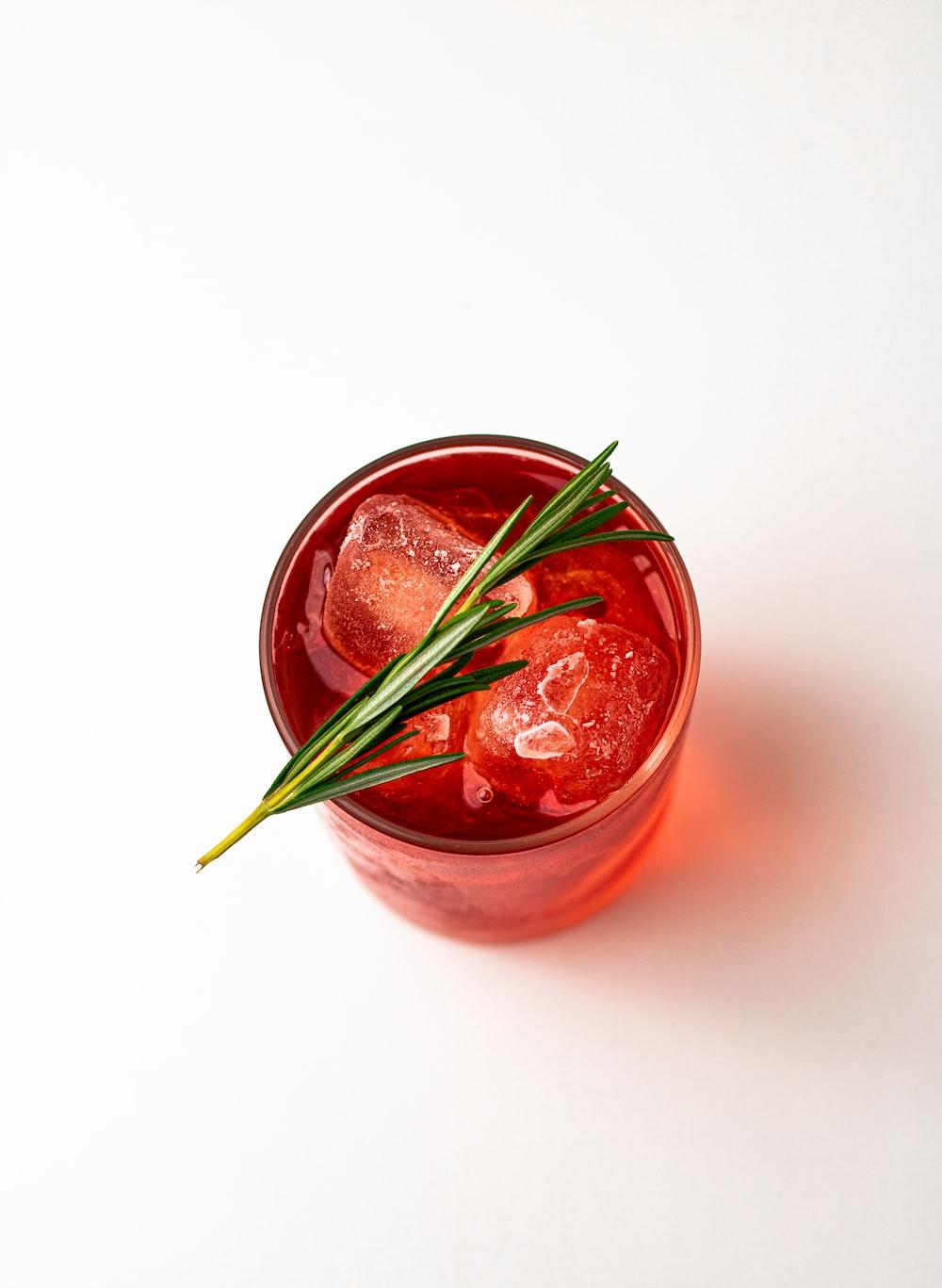 red liquid in clear glass jar
