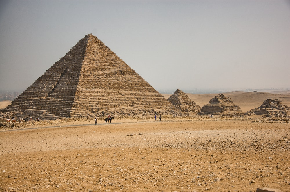 brown pyramid under gray sky during daytime