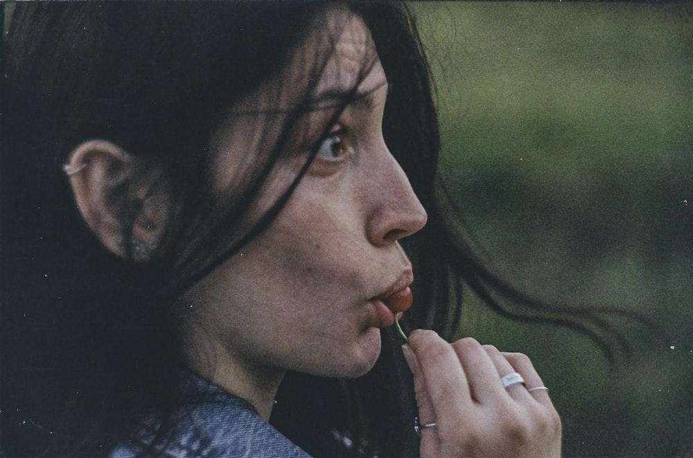 woman in black shirt smoking
