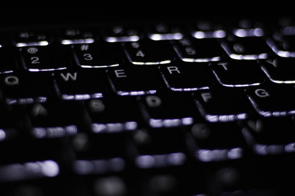 black computer keyboard on white surface