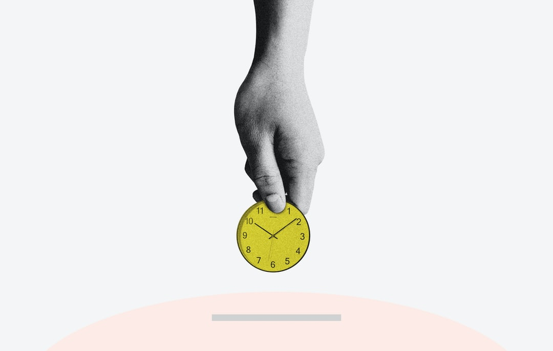 yellow round analog clock is used like a coin to demonstrate digital marketing ROI