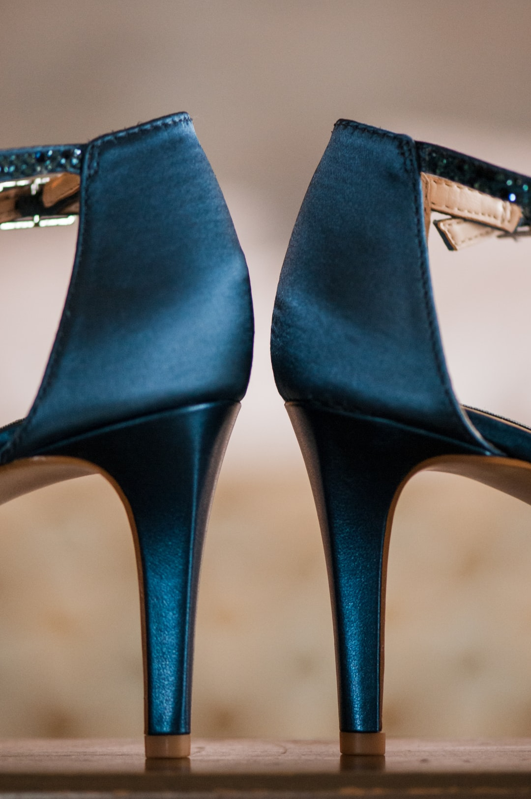 Blue high heeled (high heel) women's shoes. The blue is a smoky grey teal blue and the material is silky.