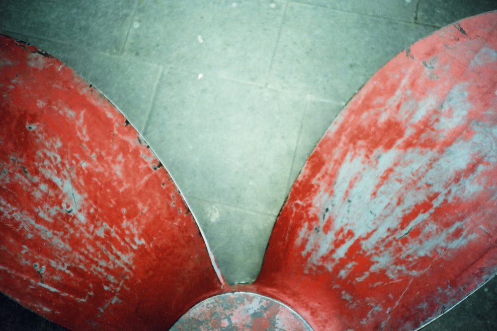 red and silver chair on gray floor tiles