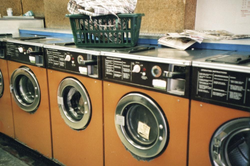 green plastic basket on front load washing machine