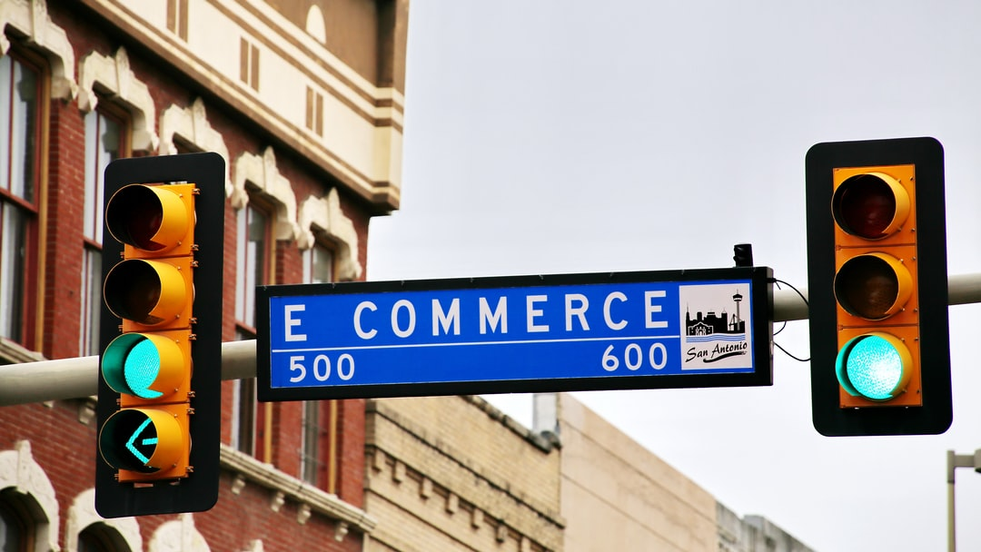 All signs on green for e-commerce? No, just East Commerce Street in San Antonio.  Tip: there is also a E Commerce Street sign available with red lights (see my photo line).