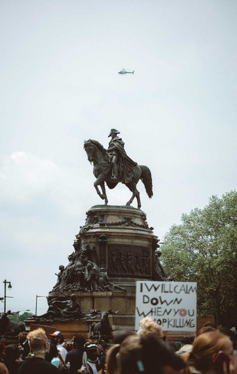 man riding horse statue during daytime