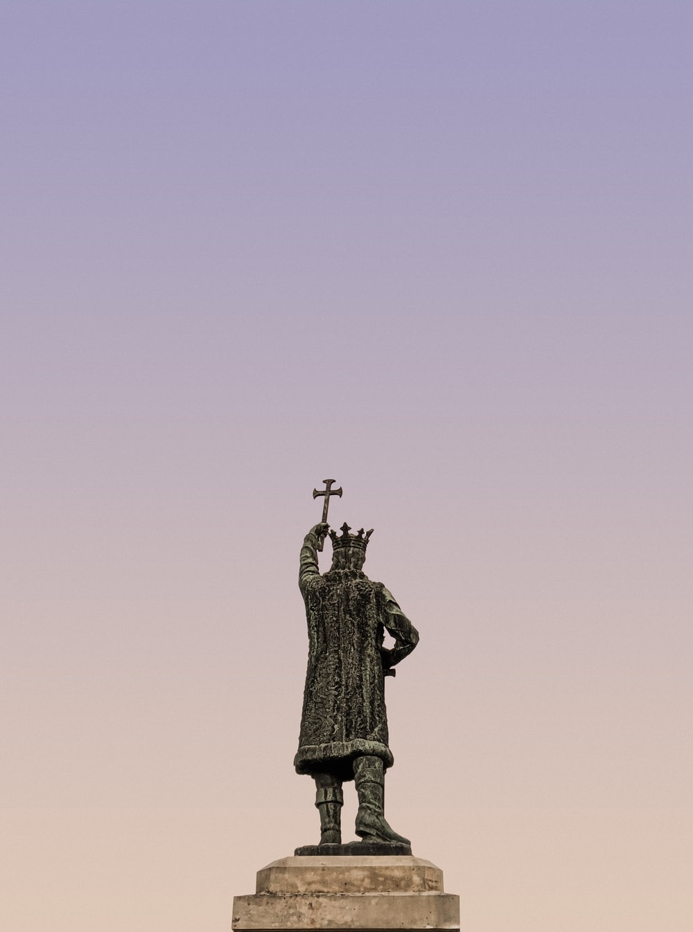 black statue of man on top of the mountain