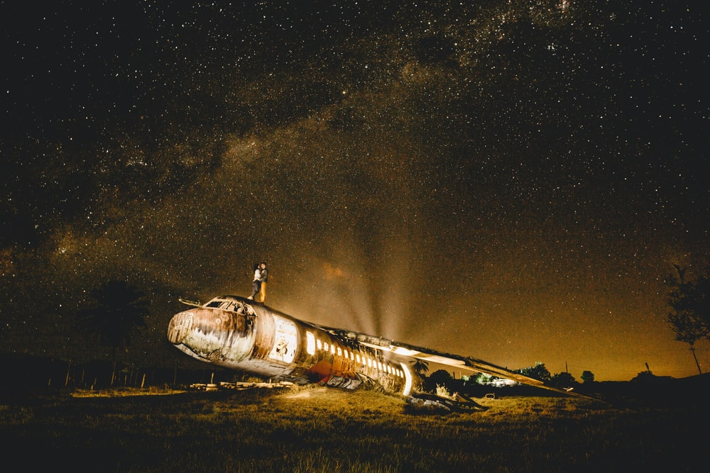 white and black plane under starry night