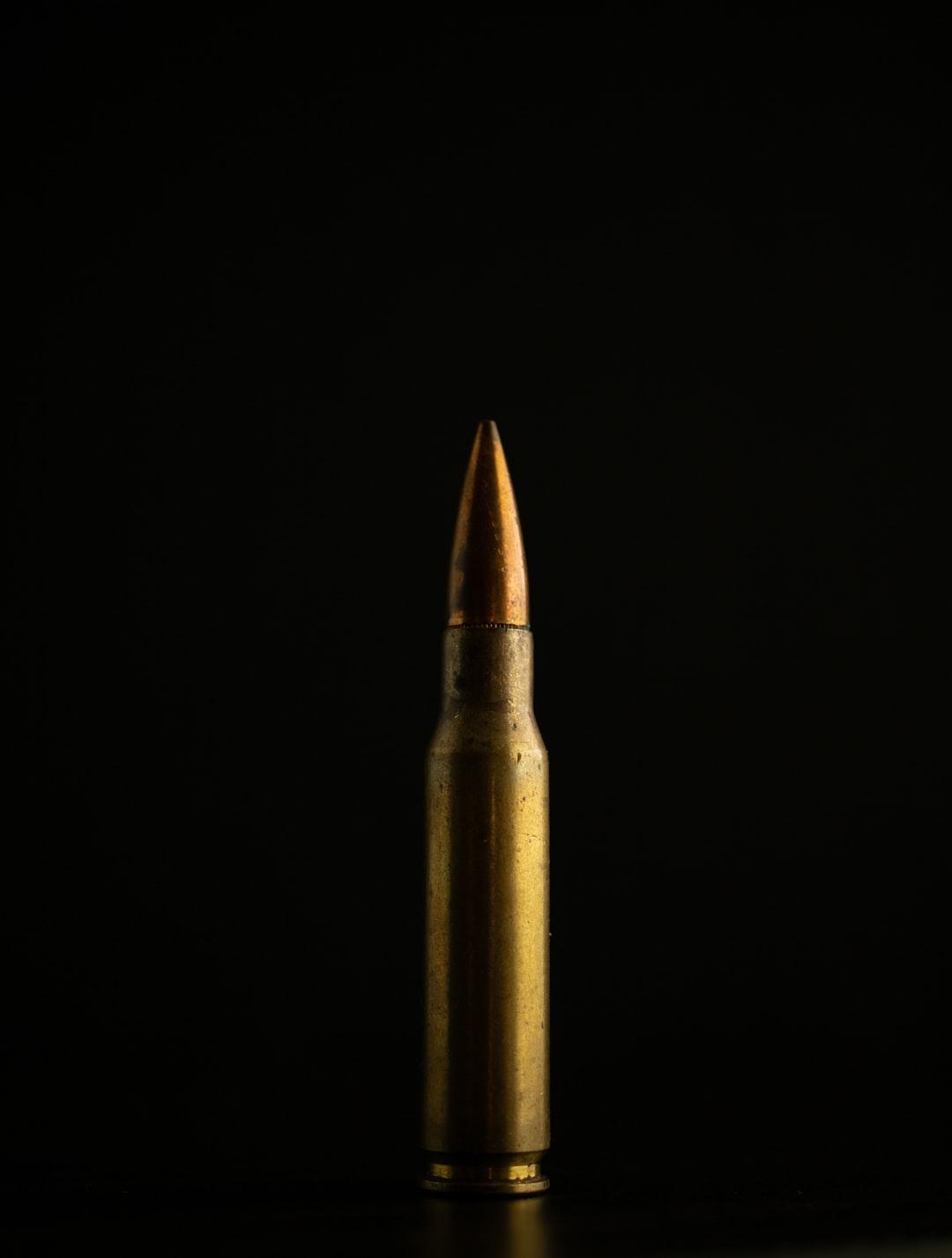 Brass bullet standing.