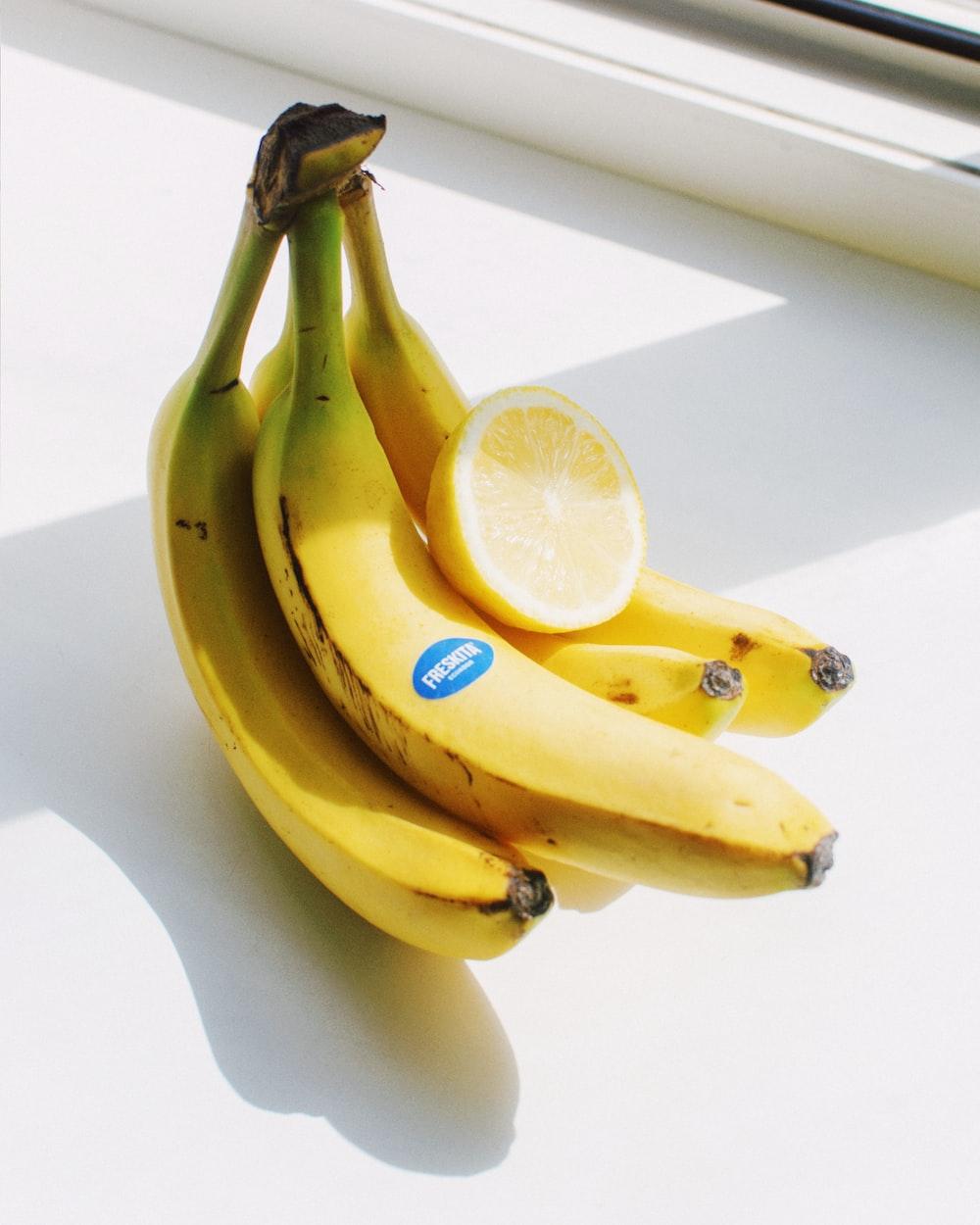 yellow banana fruit beside sliced lemon