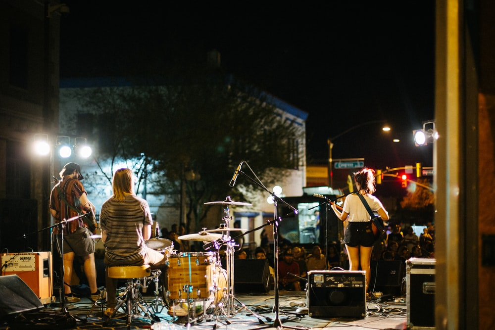 people playing musical instruments during night time