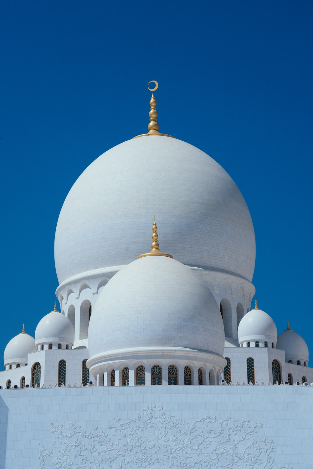 white concrete dome building under blue sky during daytime