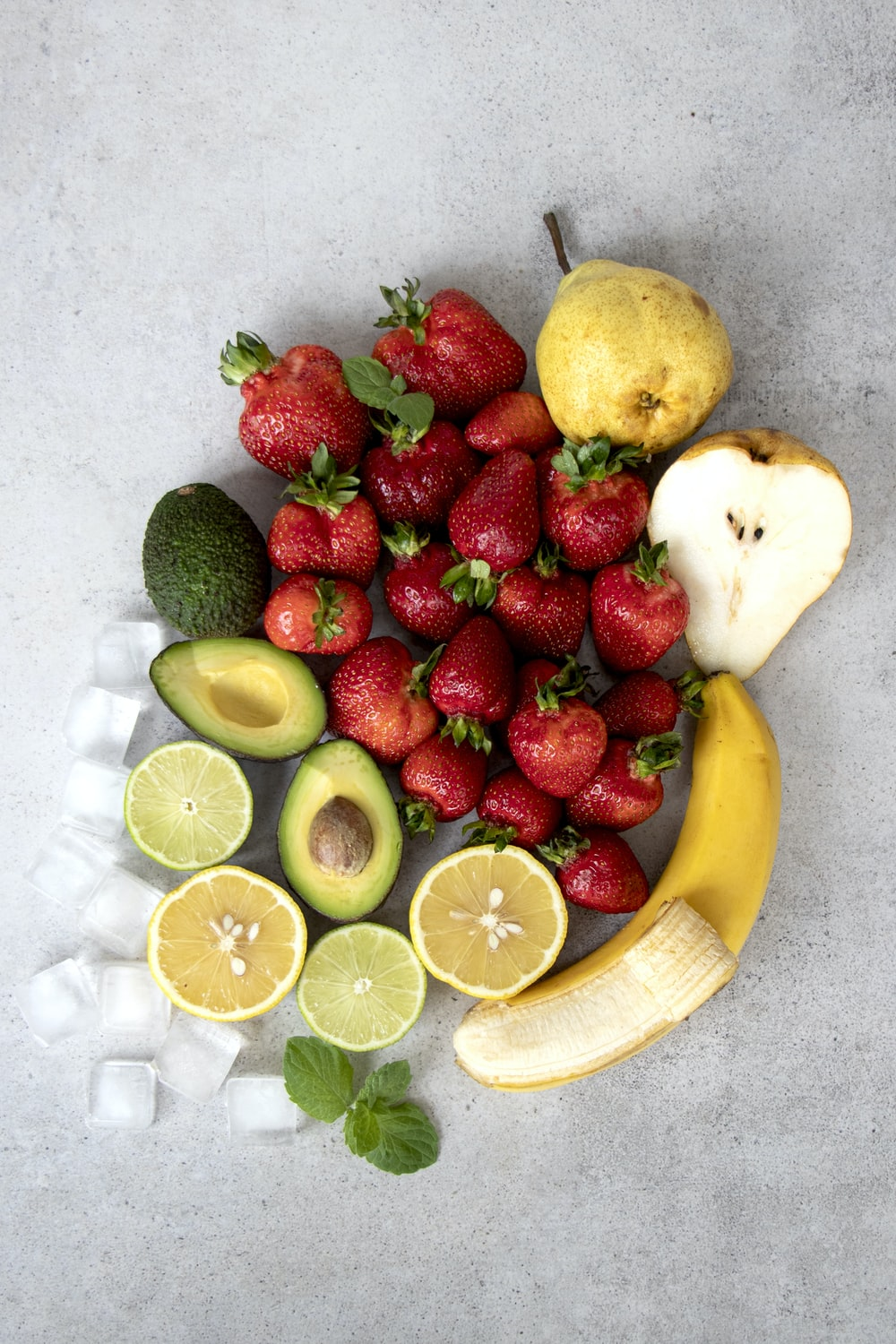 strawberries and bananas on white table