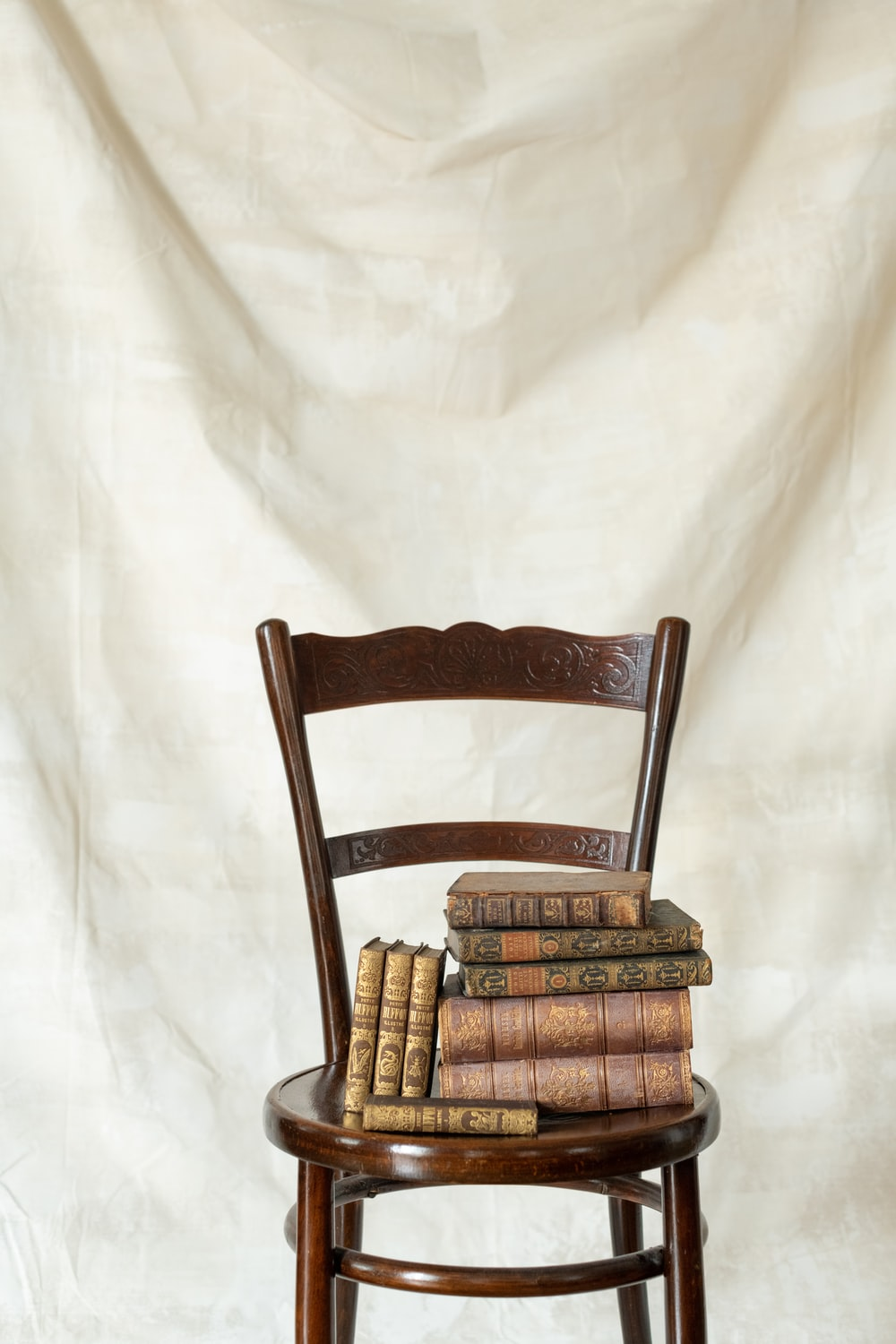 brown wooden chair on white wall