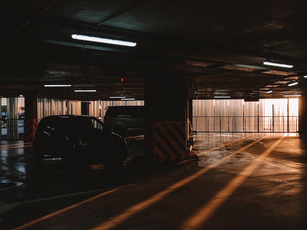 black car in garage during daytime