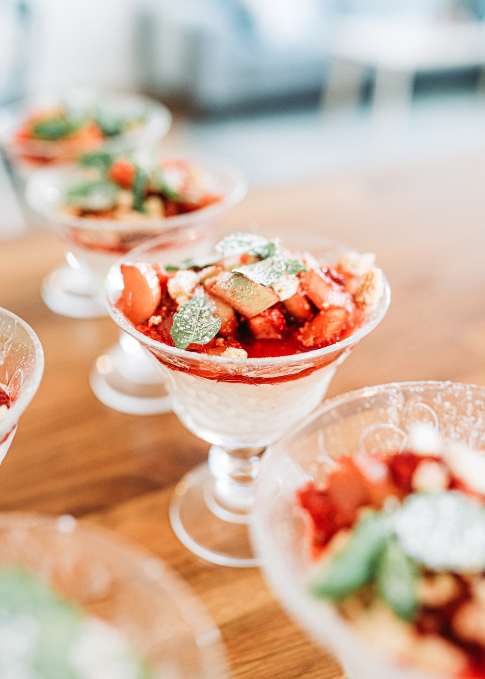 sliced strawberries in clear glass bowl