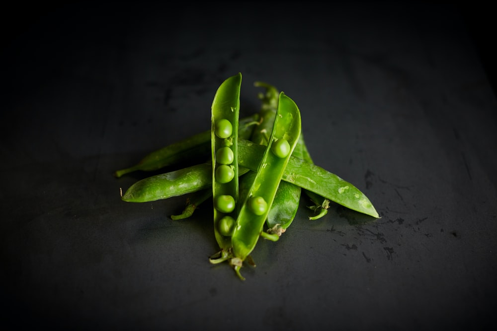 green peas on black surface