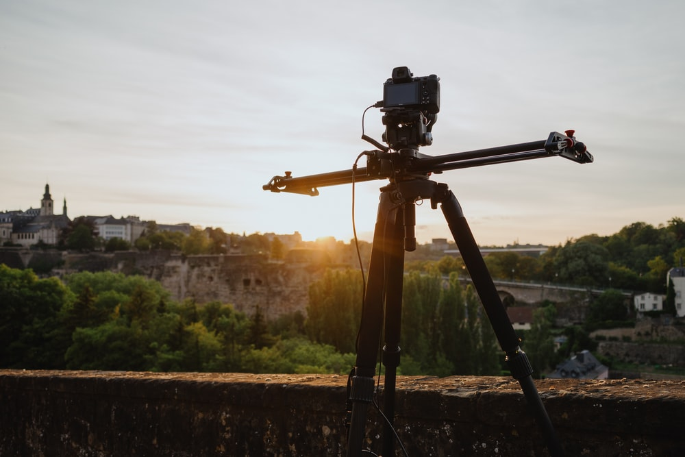 black dslr camera on tripod