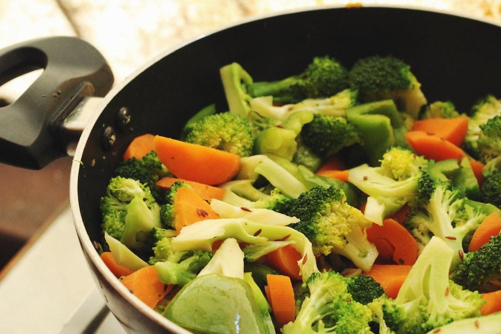green and orange vegetable salad in white ceramic bowl