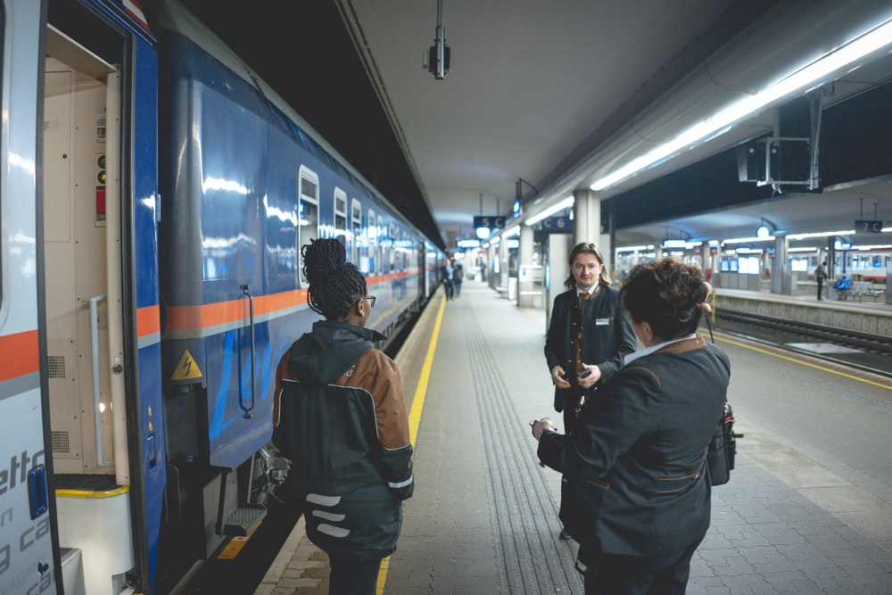 people in train station during daytime