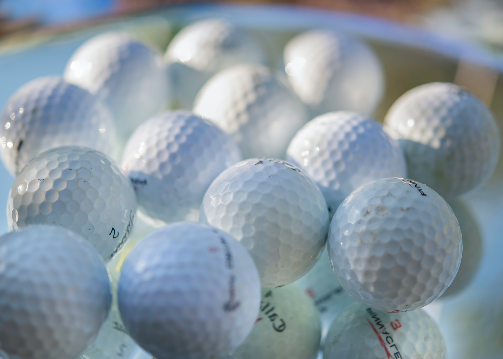 Collection of golf balls close up.