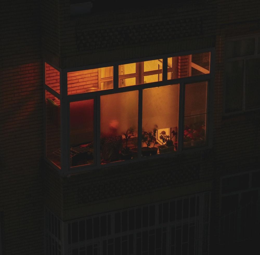 black framed glass window with lights