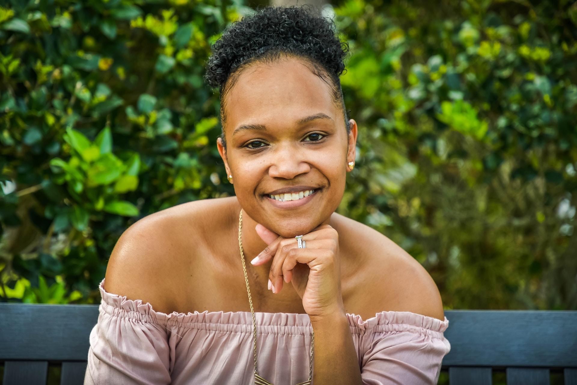 smiling girl in white tank top