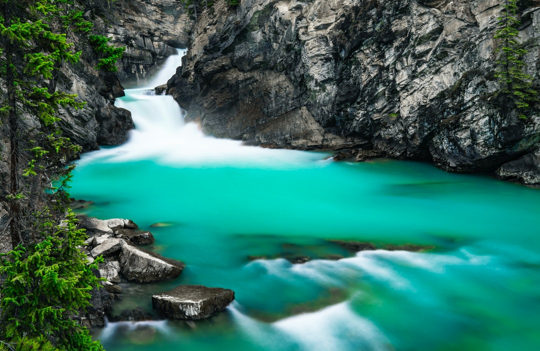 Beautiful Jade River With Soft Motion Waterfalls And Slow Shutter