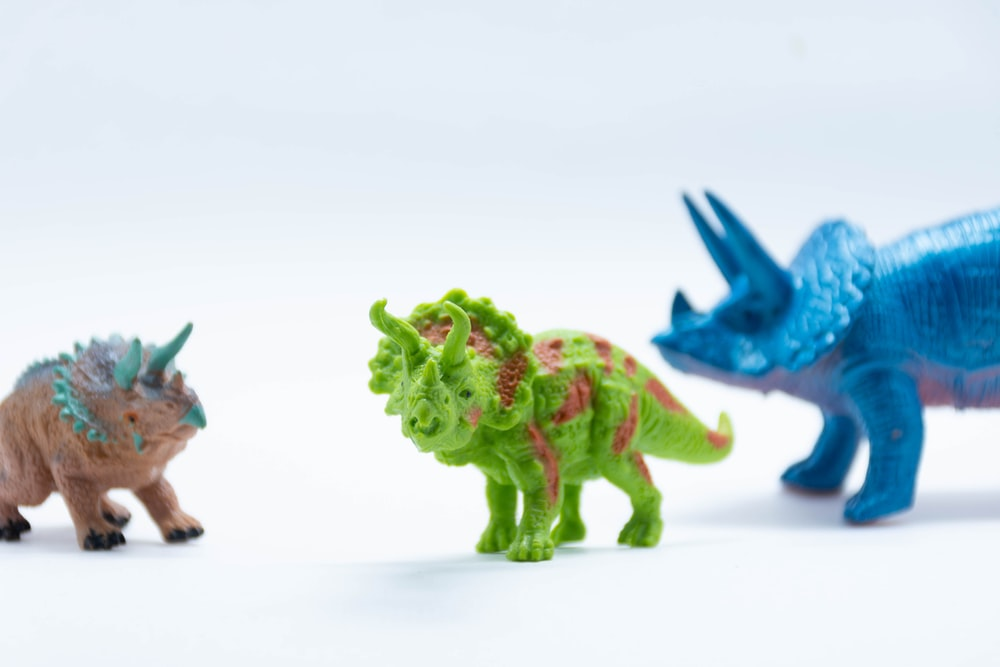 blue and green dragon plastic toy