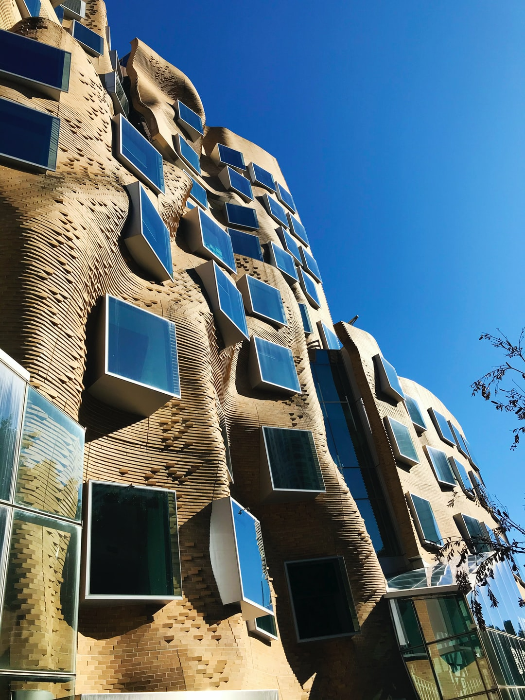 Chau Chak Wing Building designed by Frank Gehry against a Sydney winter sky,