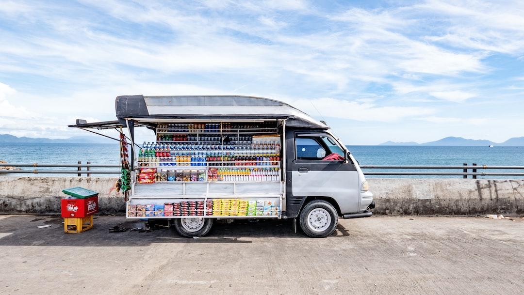 A portable kiosk selling beverages in plastic bottles