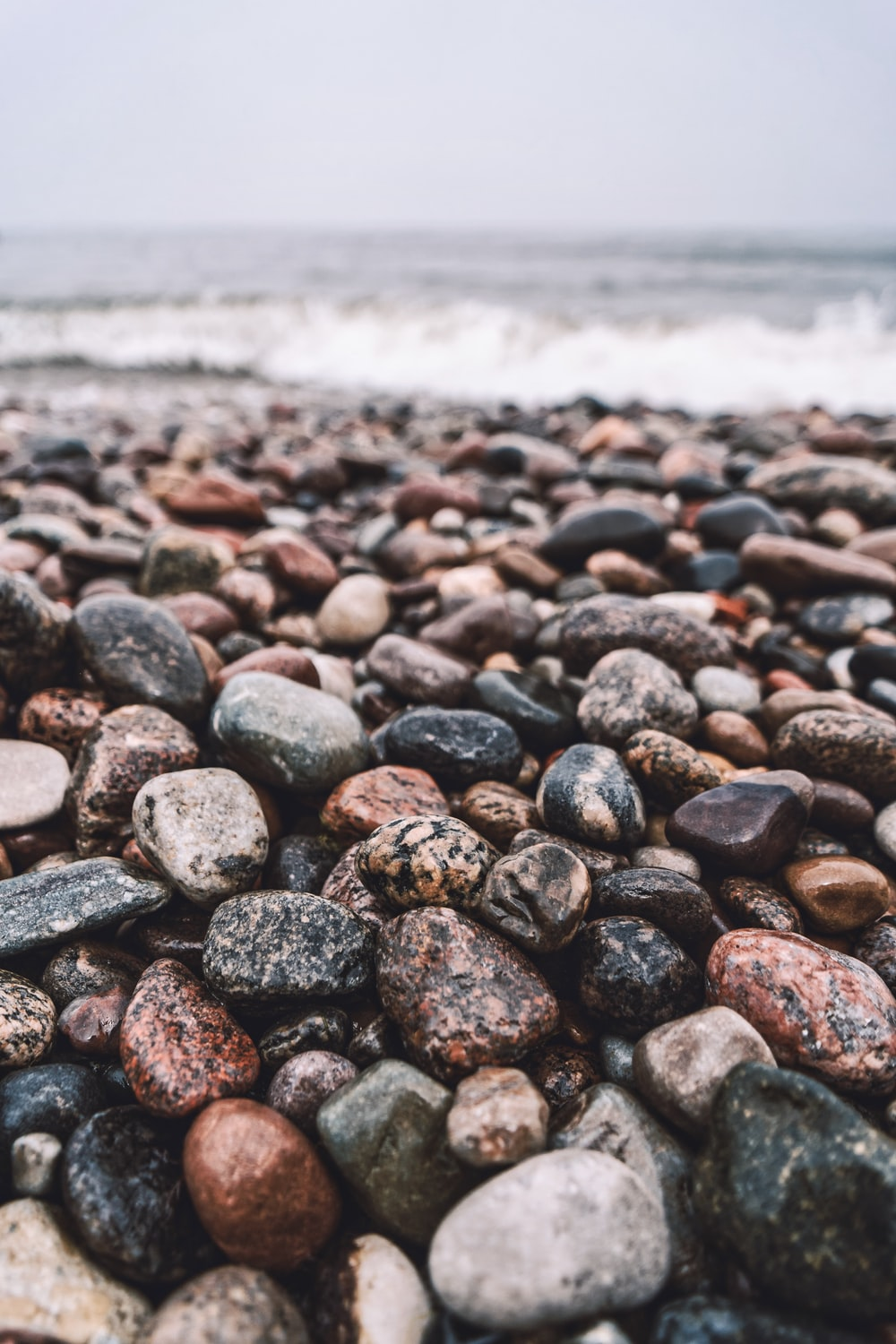 black and gray stones near sea during daytime