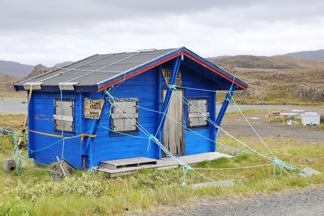 How to describe this little hut which seems to be hold together by ropes? Seen close to North Cape (Norway).  Minimum viable product?