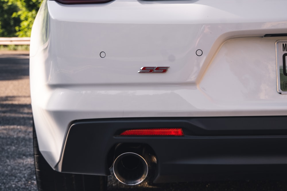 white car with red and black license plate