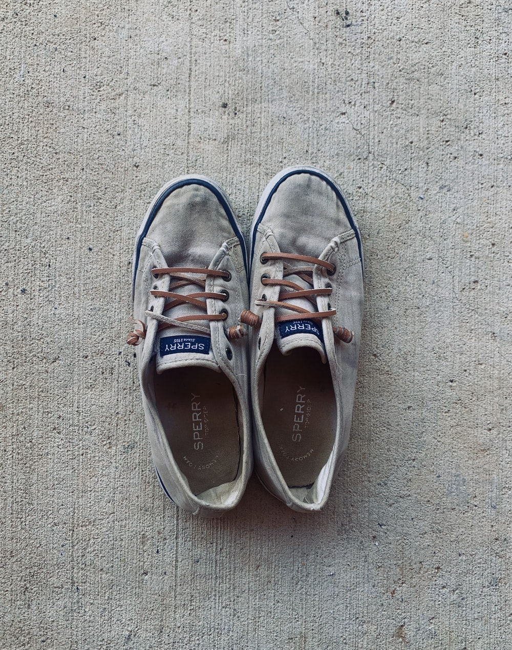 white and brown lace up sneakers