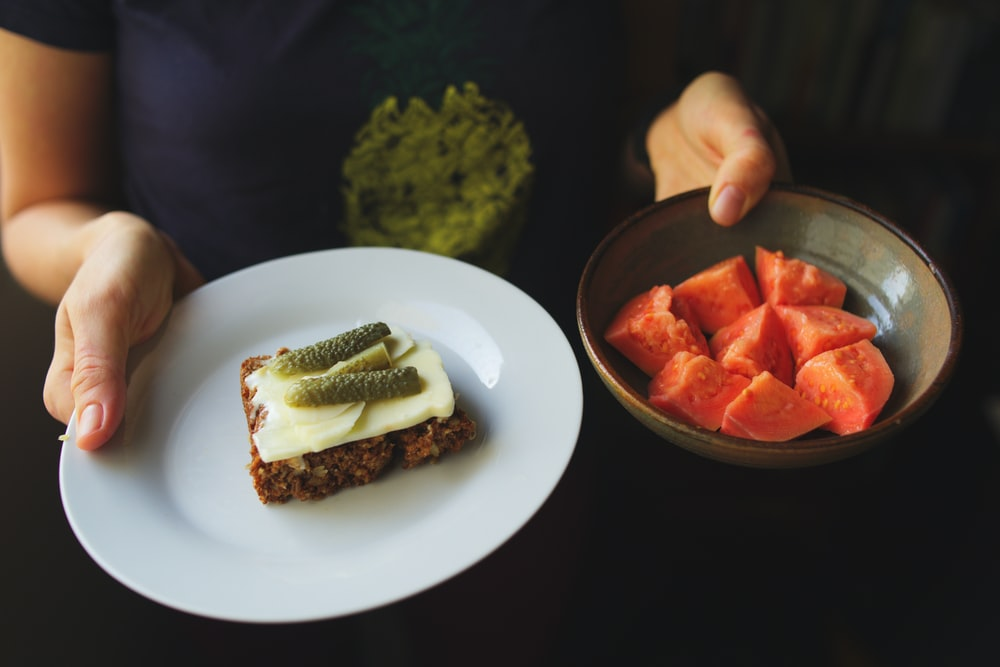 sliced tomato and cucumber on white ceramic plate